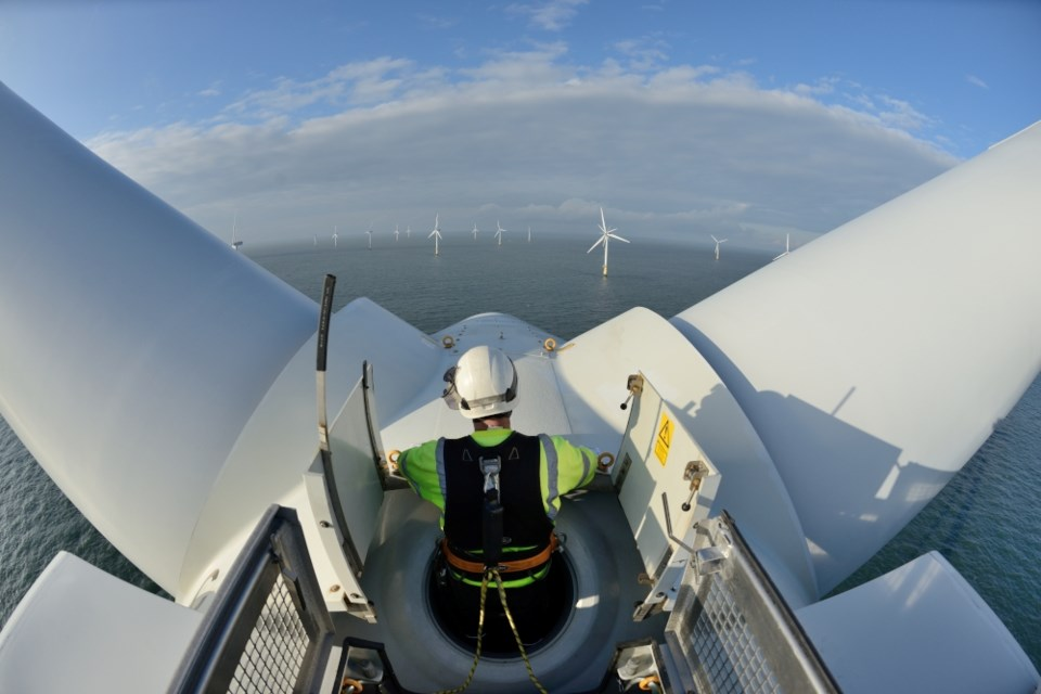 Worley technicians at work on a turbine. Picture: Worley