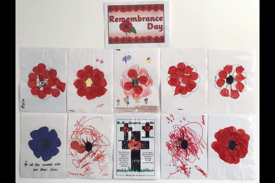 Children create poppies to join in the Remembrance Day service at East Community Centre (Picture: Kimberley Lavery)